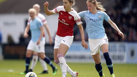 Arsenal's Vivianne Miedema (left) and Manchester City's Janine Beckie battle for the ball. Picture: