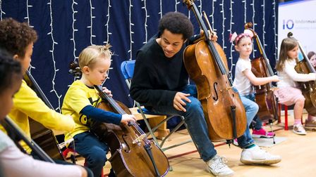 Sheku Kanneh-Mason playing alongside young cellists through London Music Masters last year. Picture: