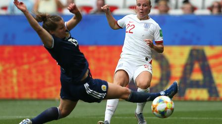 Scotland's Sophie Howard (left) and England's Beth Mead collide during the FIFA Women's World Cup, G