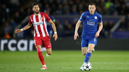Atletico Madrid's Yannick Carrasco and Leicester City's Jamie Vardy during the second leg of the UEF