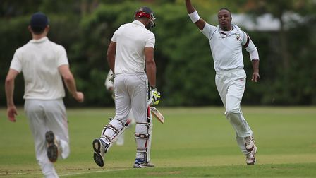 Lesbourne Edwards celebrates taking a wicket for Hornsey against Highgate (pic: George Phillipou/TGS