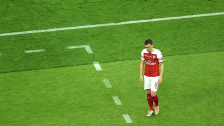 Arsenal's Mesut Ozil looks dejected after Chelsea's Eden Hazard (not pictured) scores his side's fou