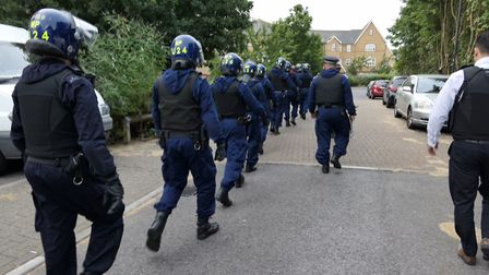 Police carry out a dawn raid in Brent. Picture: David Nathan