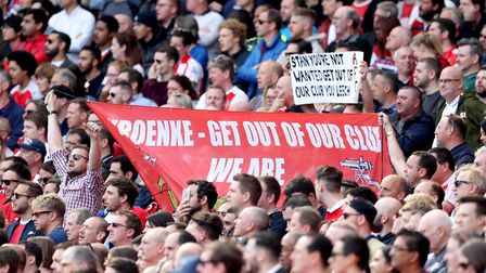 Arsenal fans hold up an anti-Stan Kroenke banner during the Premier League match at the Emirates Sta