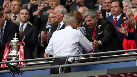 Arsenal manager Arsene Wenger shakes hands with Owner Stan Kroenke after the final whistle during th