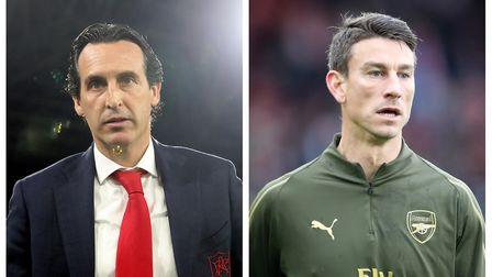 Unai Emery (left) and Laurent Koscielny. Picture: PA