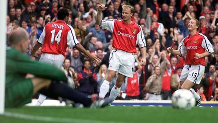 Arsenal's Dennis Bergkamp (centre) celebrates after scoring with Thierry Henry (left) and Ray Parlou