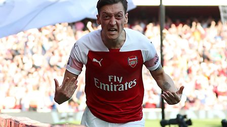 Arsenal's Mesut Ozil celebrates scoring his side's first goal of the game during the Premier League