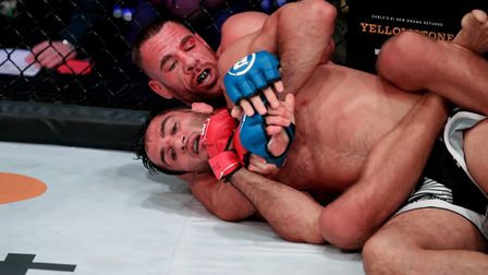 Rafael Lovato Jr and Gegard Mousasi grapple on the floor of the cage at Wembley Arena (pic Bellator