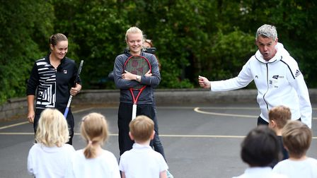 Ashleigh Barty of Australia and Harriet Dart of Great Britain take part in a schools activity during