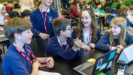 Pupil's from Kilburn Park Primary School learn to code during Amazon's Digital Careers day. Picture: