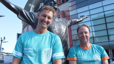 Former England Arsenal captain Tony Adams MBE with National Brain Appeal fundraiser Lewis Owens next