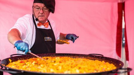 A chef cooks paella at the first Gazpacho Gatherings event last weekend.