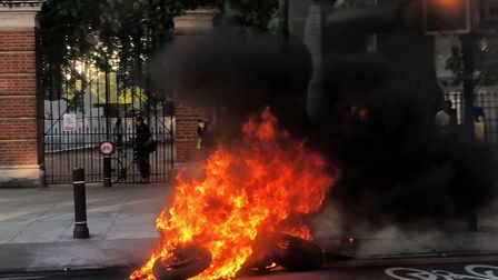 The blazing bike after the deadly crash in Seven Sisters Road. Picture: Nick Spence