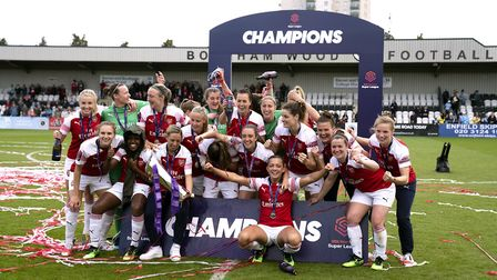 Arsenal Women's team celebrate with the FA Women's Super League trophy after the final whistle. Pict