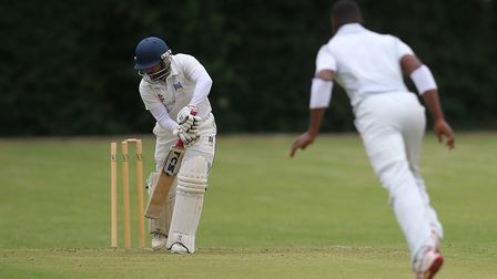 Highgate opener Hasnain Ali is bowled by Hornsey's Lesbourne Edwards (pic: George Phillipou/TGS Phot