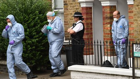 Police and a forensics team at the scene of Simonne Kerr's murder in Clapham. Picture: John Stillwel