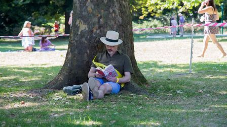 A volunteer takes a break at the Queen's Park Book Festival 2018. Picture: Cathy Teesdale