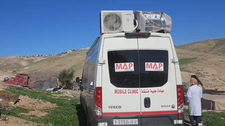 MAP's mobile health clinic visits 27 communities in West Bank, providing medical aid to those in nee