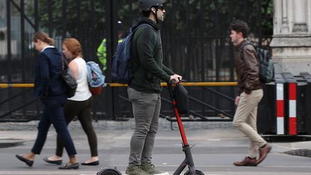 A stock photo of a person riding an electric scooter in central London. Picture: PA