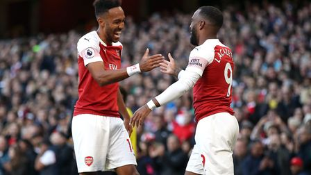 Arsenal's Alexandre Lacazette (right) celebrates scoring his side's first goal of the game with Pier