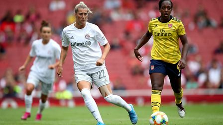 Bayern Munich's Verena Schweers (left) and Arsenal's Danielle Carter in action during the Emirates C