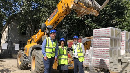 Team posed in front of digger in Redbrick Estate. Picture: Kate Robson
