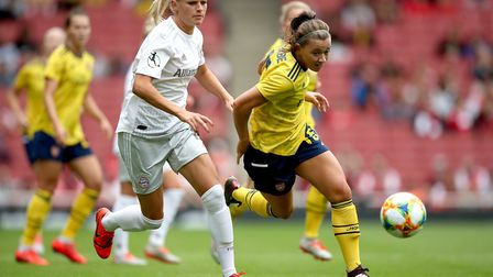 Arsenal's Katie McCabe (right) and Bayern Munich's Carina Wenninger battle for the ball during the E