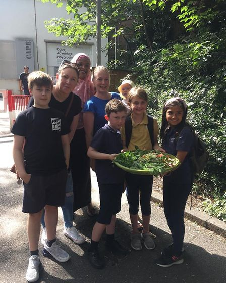 Parents and kids collect produce to give to Streets Kitchen at Ashmount Primary School. Picture: Ele