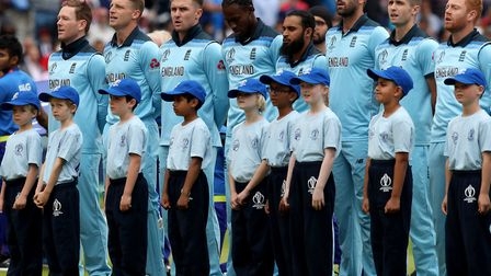 England captain Eoin Morgan (left) stands with his players and youngsters from Highgate Cricket Club