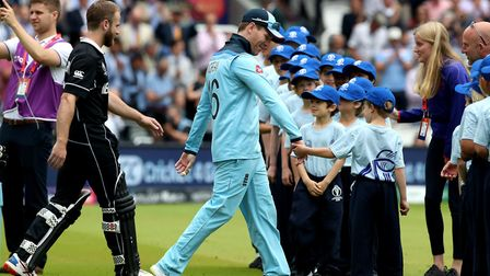 England's Eoin Morgan (centre) walks out ahead of the World Cup final at Lord's (pic: Nick Potts/PA
