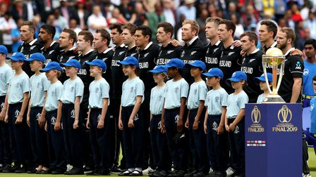 New Zealand captain Kane Williamson (right) stands with his players for the national anthem ahead of