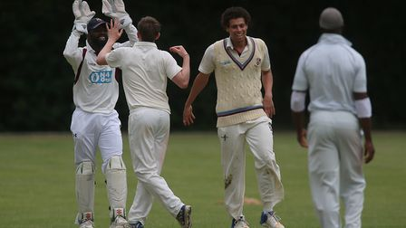 Jack Bruce celebrates a wicket with Hornsey captain and wicket-keeper Garfield Struthers (pic: Georg