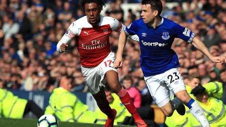 Arsenal's Alex Iwobi (left) and Everton's Seamus Coleman battle for the ball during the Premier Leag