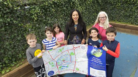 Pupils at Prior Weston School with the new ivy screen and air pollution map, with Cllr Claudia Webbe