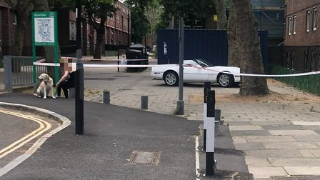 The scene after a 60-year-old man was found injured on the Elthorne Estate in Archway. He has since