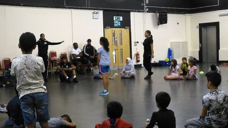 Sagal Ali (volunteer) and Samantha Triuino (assistant coach) instruct youngsters