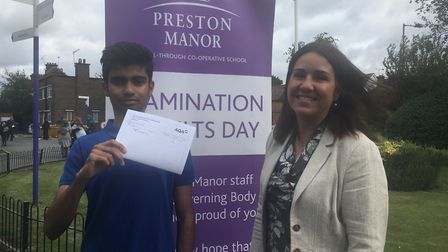 Pratik Shah is off to Oxford University with his A*AA is congratulated y Preston Manor head Beth Kob