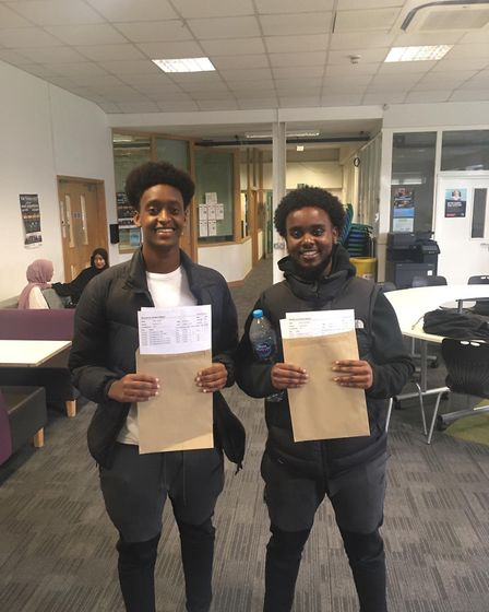 Liiban Ahmed (left) and Muhammad Rashid (right) celebrate getting their A-levels at Whitefield Schoo