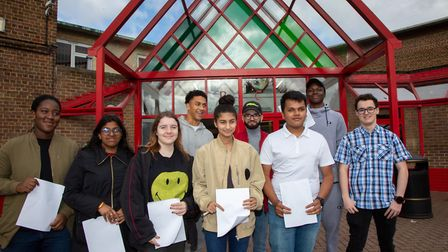 Pupils at Queen's Park Community School pick up their A-Level results. Picture: Jonathan Goldberg