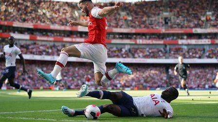 Arsenal's Sead Kolasinac (top) and Tottenham Hotspur's Moussa Sissoko battle for the ball during the