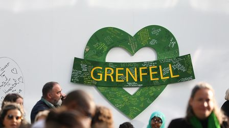 Messages left on a wall for the 72 people who lost their lives in the Grenfell Tower block outside G