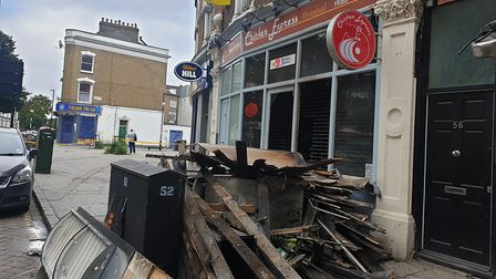 Debris outside Chicken Express in Newington Green, where there was a fire in the early hours Pictur