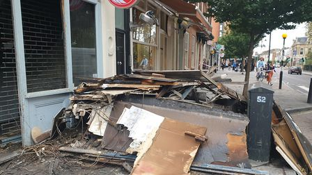 Debris outside Chicken Express in Newington Green, where there was a fire in the early hours. Pictu