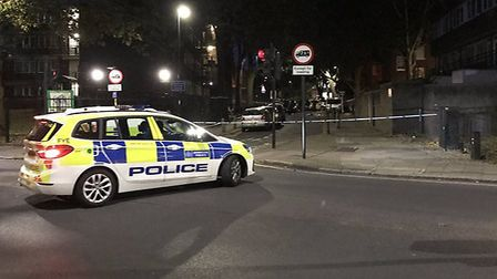 Police cordoned off Popham Street after a double stabbing. Picture: Samir Jeraj