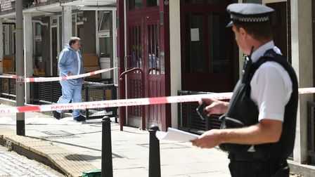 A forensic officer at the scene in Munster Square, Camden, northwest London where a 16-year-old boy