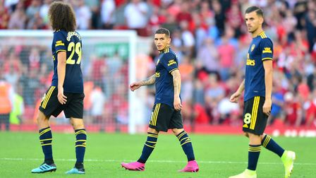 Arsenal's Matteo Guendouzi (left), Lucas Torreira and Dani Ceballos after the final whistle during t
