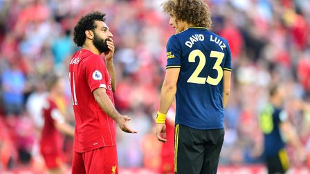 Liverpool's Mohamed Salah (left) and Arsenal's David Luiz after the final whistle during the Premier
