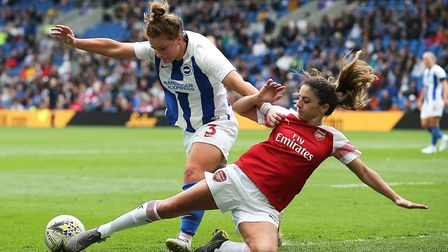 Arsenal's Danielle van de Donk and Brighton's Felicity Gibbons battle for possession during the FA W