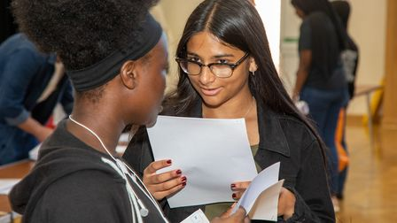 Amira Ahmed of Queen's Park Community School gets GCSE results. Picture: Jonathan Goldberg
